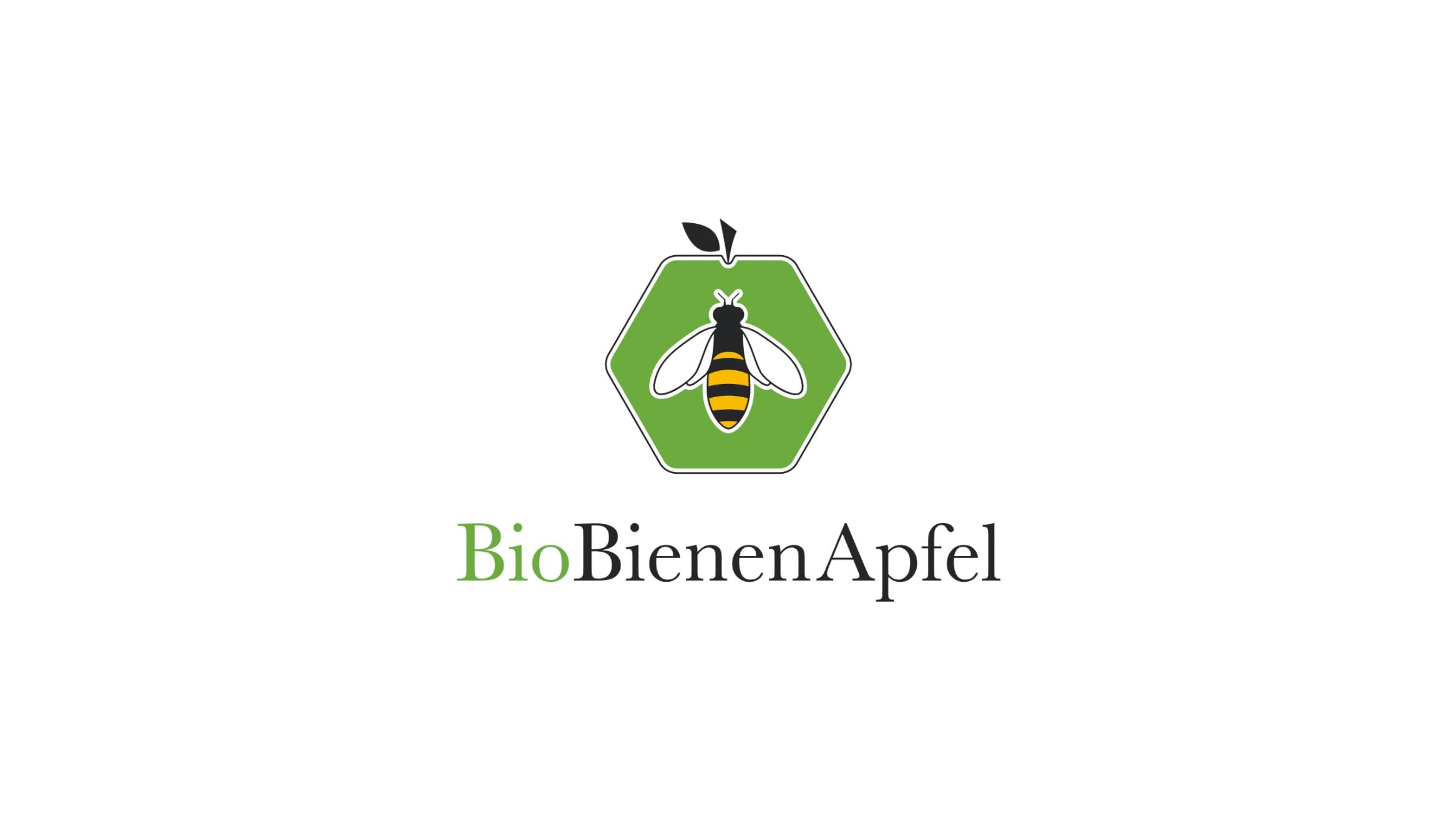Grüner Apfel in Form einer Bienenwabe mit einer Biene in der Mitte, Logo von BioBienenApfel